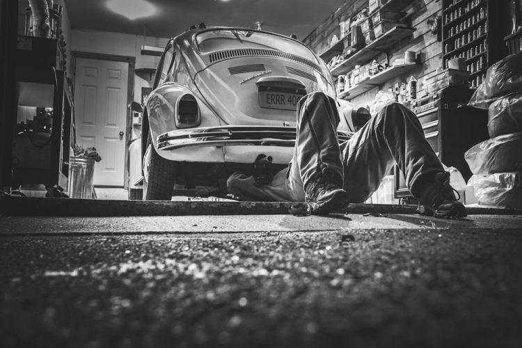 A car in a repair shop - license plate ERRR 404